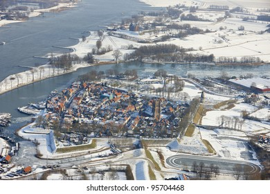Winter aerial view of the town Woudrichem with in the background Castle Loevestein, Noord-Brabant, Netherlands