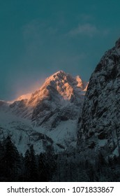 winter alpine mountain landscape during sunset, kamnik alps,  slovenia.