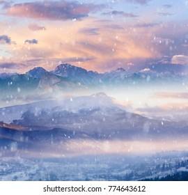 Winter Alpine mountains snowy landscape at sunrise