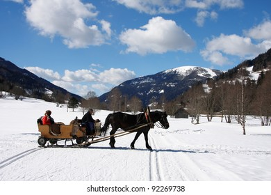 Winter in Alps,  sleigh with horse