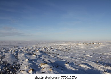 Winter arctic landscape with snow on the ground near Arviat, Nunavut