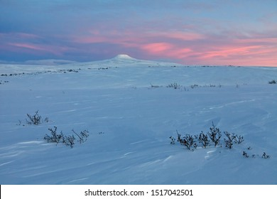 Winter arctic landscape. Tundra and hills covered with snow. Dawn. Morning twilight before sunrise. Hard-to-reach areas of the Far North in the Arctic. Chukotka, Siberia, Far East Russia. Polar region