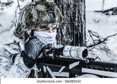 Winter arctic mountains warfare. Action in cold conditions. Sniper with weapons in forest somewhere above the Arctic Circle