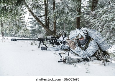 Winter arctic mountains warfare. Action in cold conditions. Sniper and spotter with weapons in wait somewhere above the Arctic circle