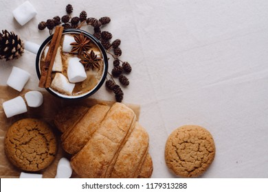 Winter and autumn hot drink. Hot chocolate or cocoa with marshmallow , cookies and spices on white background.