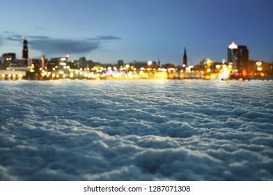 Winter background with blurred city lights