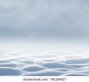 Winter background with deep snowdrifts for design