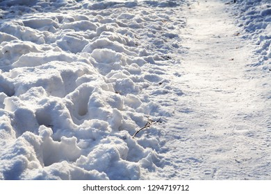 Winter background with footpath across snow
