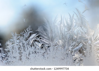 Winter background. Frost and ice crystals on window glass.