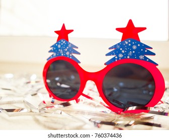 Winter Background glasses for celebrating the New Year holiday Happy New 2018 year in red tones