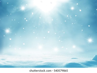 Winter  background with snow and blurred bokeh.Merry Christmas and happy New Year greeting card with copy-space