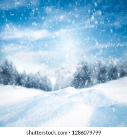 Winter background of snow with frost and landscape of forest and mountains. Free space for your decoration