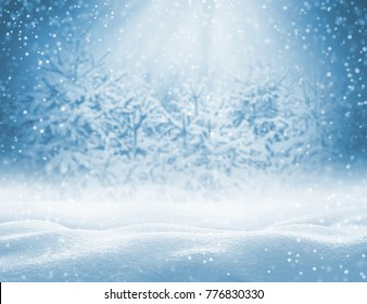 Winter background with snowdrifts for greeting card.  Christmas landscape with snowdrifts and pine branches in the frost.