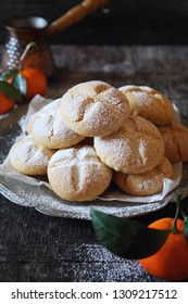 Winter baking. Homemade tangerine cookies and coffee in cezve. Rustic style