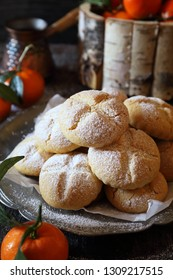Winter baking. Homemade tangerine cookies and coffee in cezve, powdered sugar dressing. Rustic style