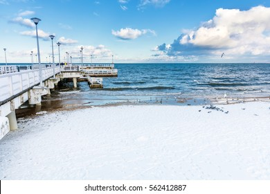 Winter Baltic sea scenery. Pier in Gdansk Brzezno, Poland. Snowy, sunny day