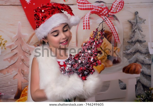 winter beautiful girl with frozen berries, Christmas and new year