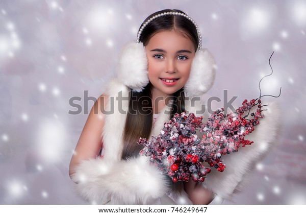 winter beautiful girl with frozen berries