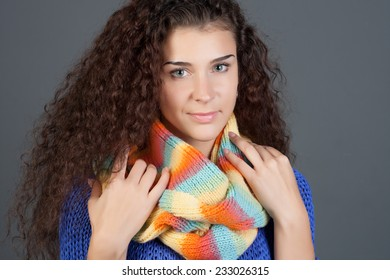 Winter Beauty Woman. Fashion Girl Concept. Skin and hair care in cold season. Beautiful woman with long hair wearing a sweater, scarf, hat and gloves.