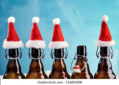 Winter beer bottle merry christmas party. Beer Bottles in a row with funny christmas hats for xmas happenings