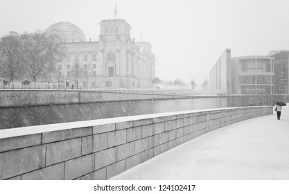 Winter in Berlin City with walking People and The Reichstag building (Bundestag) - famous landmark in Berlin, Germany, Europe