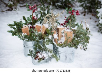 Winter Berries and Greenery in Snow