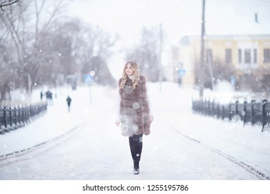 winter blonde / young adult model, blonde with long beautiful hair posing in the winter season