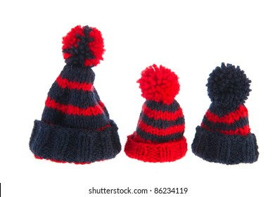 Winter bonnets knitted in blue and red isolated over white background