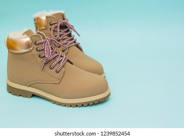 Winter boots isolated on the blue background