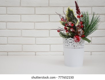 Winter bouquet on a white brick wall background