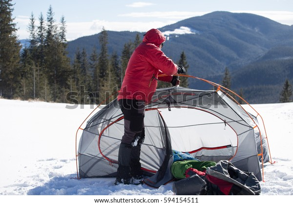 winter campaign in the day off with a tent