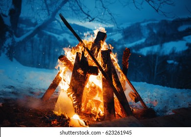 Winter campfire in the top of the mountains at the evening