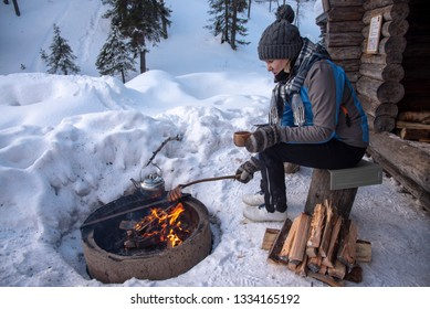 Winter camping at fireplace