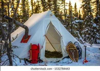 Winter camping in a tent.  Canadian wilderness in cold weather.  Adventure and snowshoeing