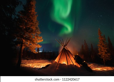 Winter Camping Under Northern Lights