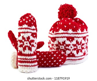 winter cap and mittens hand knitted with jacquard motifs, isolated