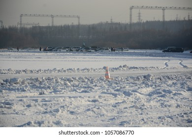 Winter car racing on the river.