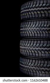 Winter car tires on black background