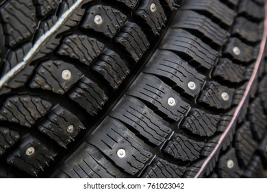 Winter car tires with spikes