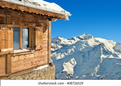 winter chalet in french alps mont blanc on blue sky background