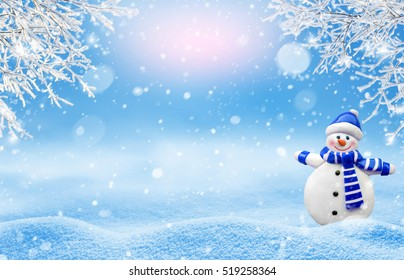 Winter Christmas background with branches in hoarfrost and cheerful snowman