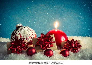 Winter Christmas concept. Baubles, gifts and christmas tree on a white snow.
