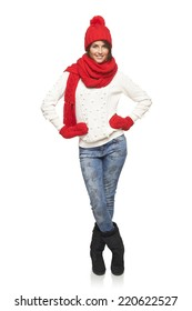 Winter, christmas, holidays concept. Smiling beautiful woman in red hat, scarf and mittens standing in full length over white background