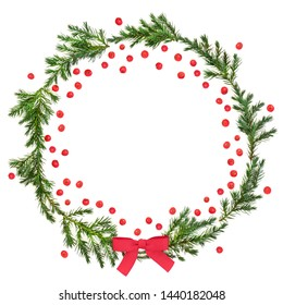Winter and Christmas juniper fir wreath with red bow and loose holly berries on white background with copy space. Traditional symbol for the festive season. Juniperis chinensis.