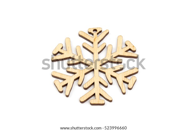 Winter, Christmas, New Year wooden decoration - snowflake, star. Isolated on white background. Top, side view. Closeup.