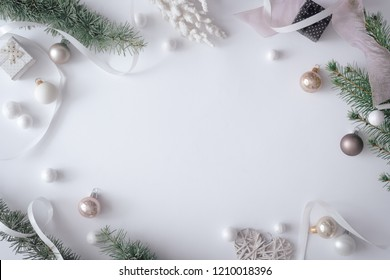 Winter Christmas table layout with New Year decoration on pastel grey background. Minimal nature concept. Flat lay top view composition.