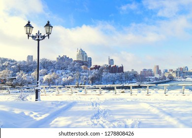 Winter  city landscape, covered with snow with a beautiful lantern.  View of the buildings,  skyscrapers  and towers,  Ukraine,  Dnepropetrovsk,  Dnipro