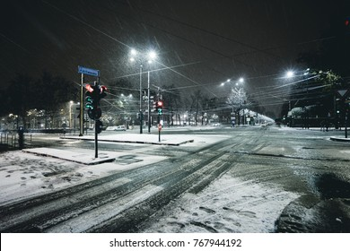 Winter city street in the night under the snow in Turin Italy