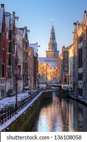 Winter cityscape of the Oudezijds kolk in Amsterdam, the Netherlands, with the Oude Kerk (old church, 1213) in the background. HDR