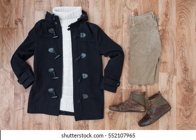 Winter clothing top view on wooden background